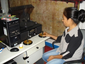 CAVR Archives staff digitising audiocassettes.