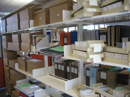 In progress: Thirty archive boxes (at left) of now-sorted but not fully described materials. [CHART photo]