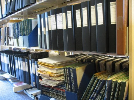 An archivist's joy: A grand mix of labelled folders, journals and unsorted document clumps.